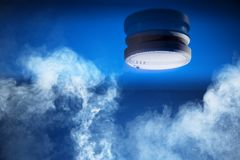 smoke-detector-blue-background-29806530